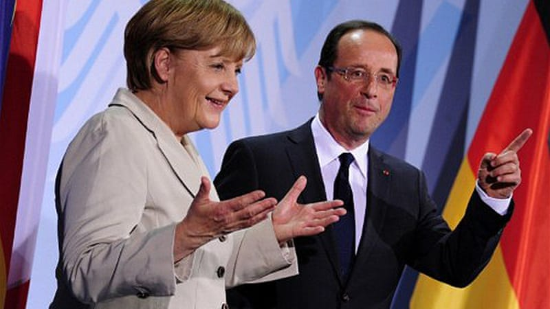 Francois Hollande met Angela Merkel hours after being sworn-in as France's new president [AFP]