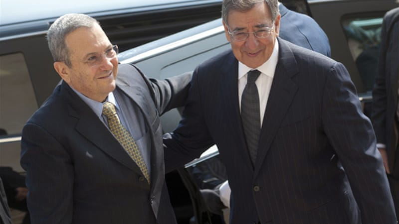 Leon Panetta, right, told Ehud Barak, left, the Pentagon would seek extra funding for the Iron Dome system [AFP]