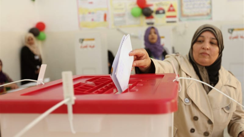 A Libyan woman casts her vote at a polling station during the local council elections in Benghazi in May [Reuters]