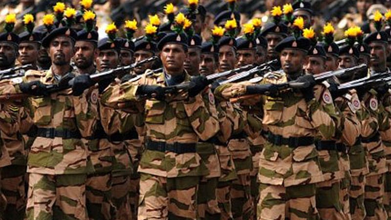 Sri Lankan police personnel have marched in a military parade during a Victory Day parade in Colombo [AFP]