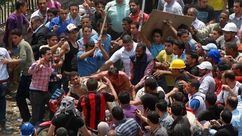 At least 11 people died in an attack on anti-military protesters outside the defence ministry in Cairo [AFP]