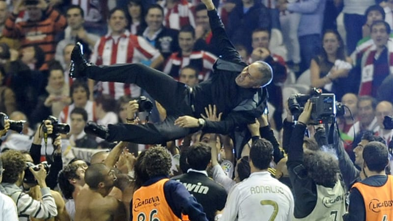 An uncomfortable Jose Mourinho celebrates bringing league success to another European club [AFP]