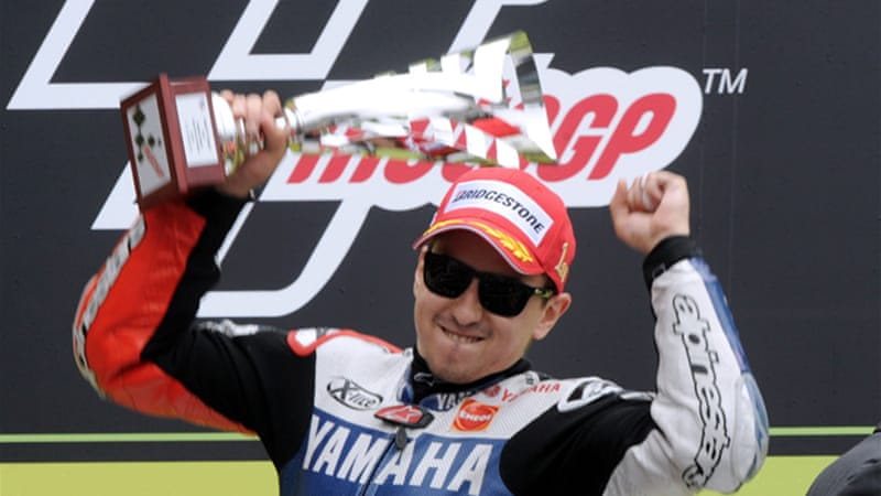 Spaniard Lorenzo celebrates victory of French MotoGP at Le Mans circuit [AFP]