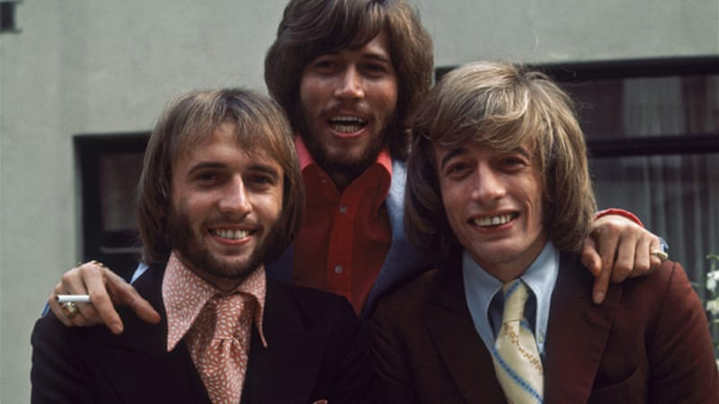 Robin Gibb and his brothers Barry, centre, and Maurice, left, were part of the singing trio the Bee Gees [GALLO/GETTY]