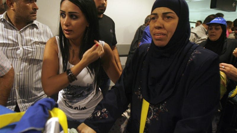 Lebanese Shia women (right), whose husbands were kidnapped in Aleppo, arrived at Beirut airport on Tuesday [AFP]