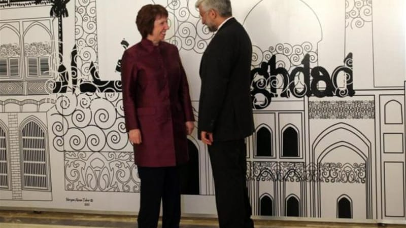 Catherine Ashton, EU foreign policy chief, presented a package of new incentives on behalf of the P5+1 to Saeed Jalili, Iran's chief negotiator [AFP]