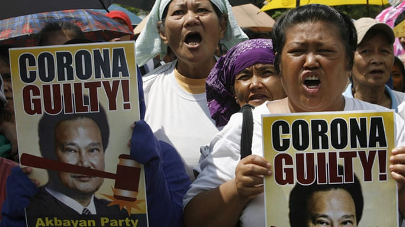 Demonstrators calling for Corona's conviction have been rallying outside the court [Reuters]