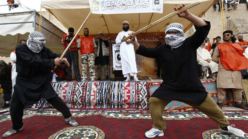 Tunisian Salafists put on a martial arts display at a May 20 rally in the central town of Kairouan [Reuters]