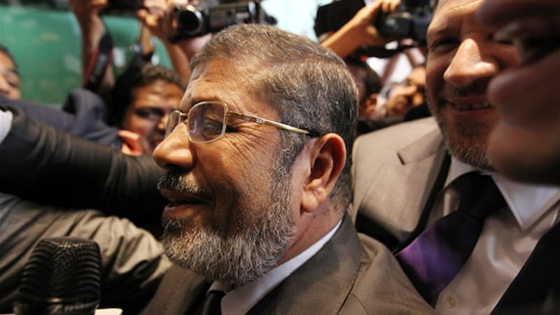 "Dismissed as the Muslim Brotherhood's ""backup candidate,"" Mohammed Morsi received the largest share of votes [EPA]"