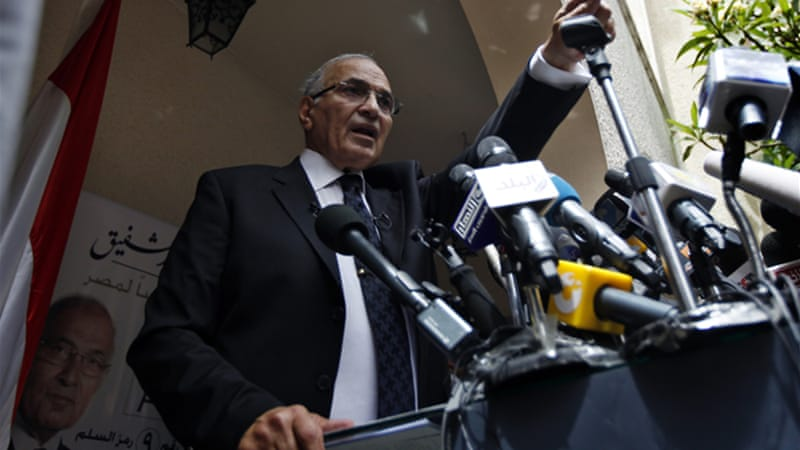 According to post-Mubarak Egyptian law, presidential candidate Ahmed Shafiq should have been technically disqualified due to his affiliation with the previous regime - yet he is now a frontrunner in the bid for the presidency [AP]