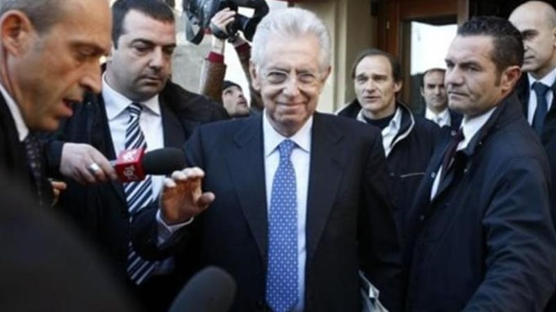 Monti is positioning himself as a mediator between Merkel and Hollande [Reuters]