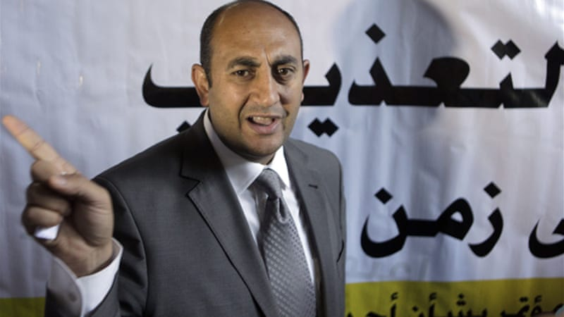 Egypt's youngest presidential candidate, Khaled Ali, joined dozens of activists on hunger strike to protest the continued detention of more than 300 people who face possible military prosecution [AP]