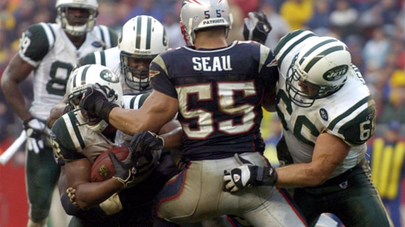 Seau, pictured above playing for the New England Patriots joins a list of several dozen American football players who suffered chronic traumatic encephalopathy (CTE) [EPA]