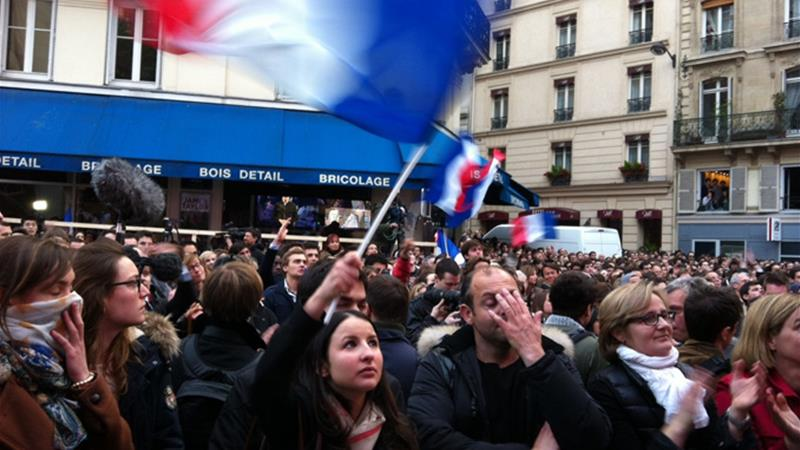 Crowds of Sarkozy supporters continued to cheer for him after his defeat [Cajsa Wikstrom/Al Jazeera]