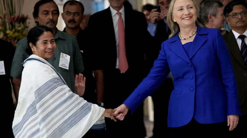 Clinton, right, also met with West Bengal Chief Minister Bannerjee, left, to discuss restrictions on foreign firms [EPA]