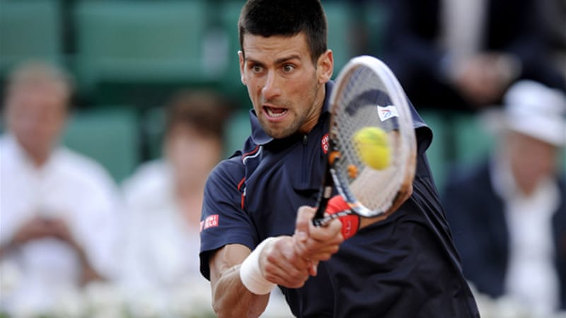 No troubles for the top seed - Novak Djokovic extended his Grand Slam winning streak to 24 matches with an easy win against Nicolas Devilder of France [EPA]