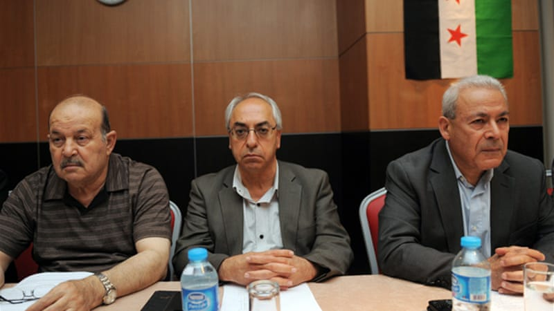 Abdel Basset Sieda (centre) replaces Burhan Ghalioun (right) as leader of Syria's main opposition group [AFP]