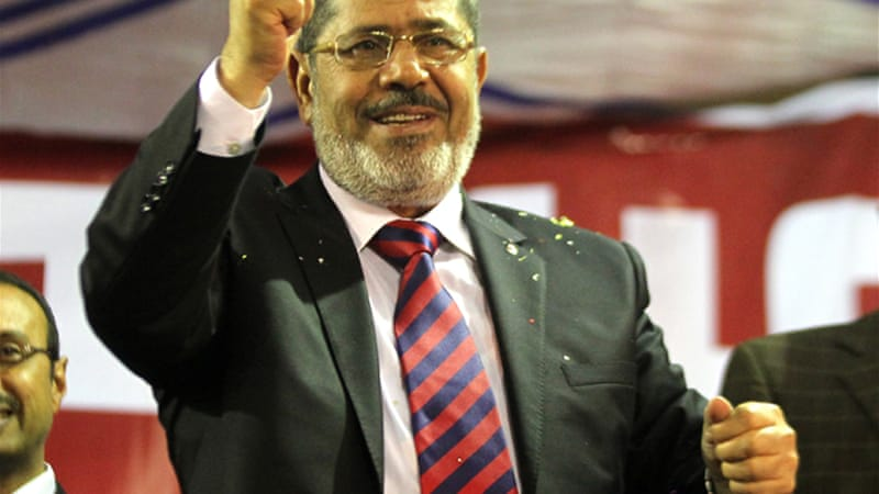 To many voters, the Muslim Brotherhood's Mohamed Morsi represents a break with the former regime [EPA]