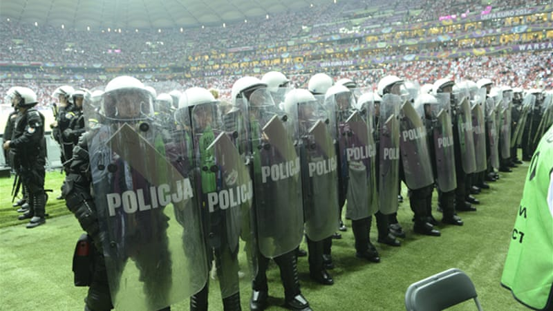 Riot police used water cannons and tear gas on Polish and Russian fans before the game, but European football's governing body criticised the spirit of the heavy police presence at the stadium [EPA]
