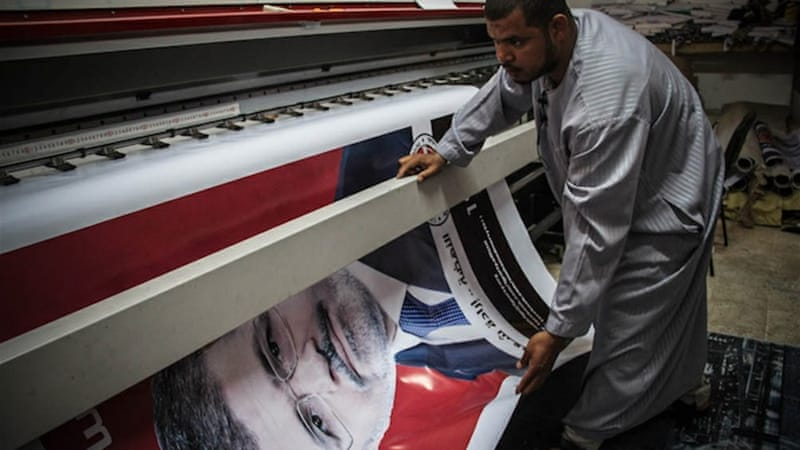 Khalifa has been into printing for a few years and doesn't only print electoral banners [Mosa'ab Elshamy/Al Jazeera]