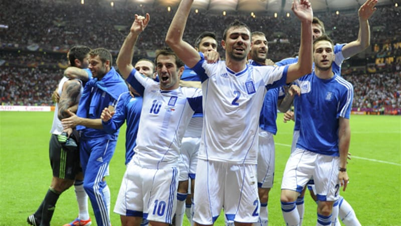 Greece, shock champions in 2004, sealed an improbable quarter-final spot by kicking Russia out of the tournament [Reuters]