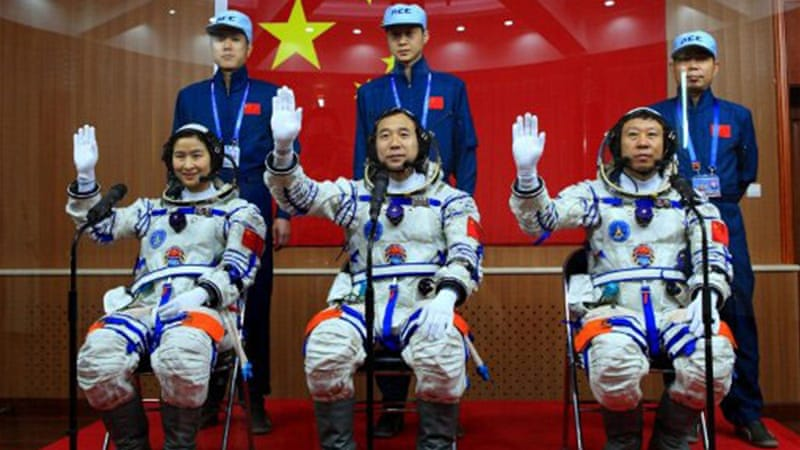 Liu Yang, left, the country' first woman to travel to space, is among the three crew memebers [AFP]