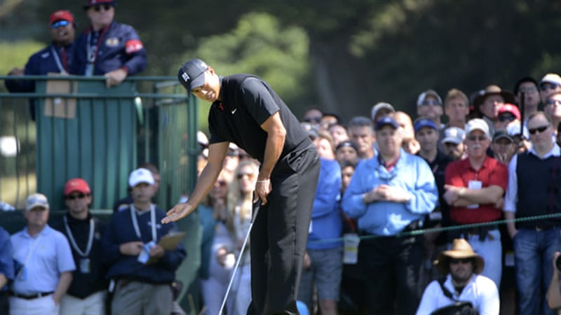 Woods is sitting on one-under par 139 with David Toms and Jim Furyk as McIllroy and Donald fail to make the cut [EPA]