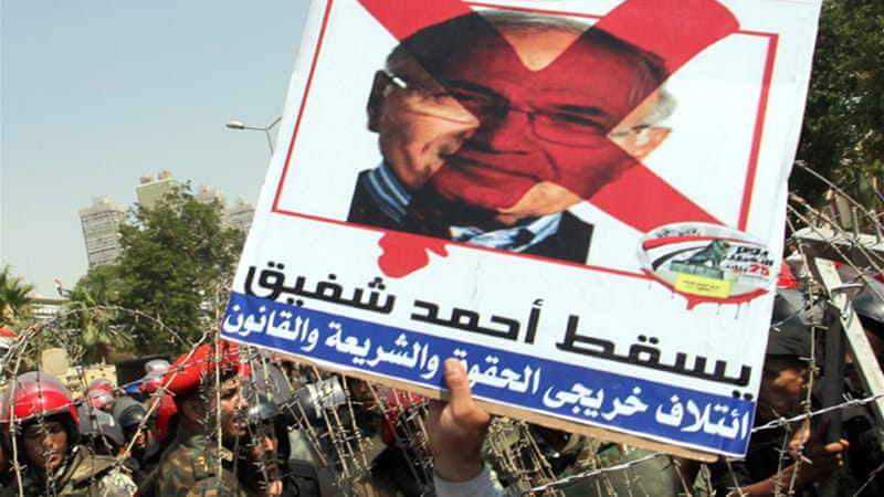 Ahmed Shafik lost the last presidential race to Mohamed Morsi, who was in turn ousted by the army  [EPA]