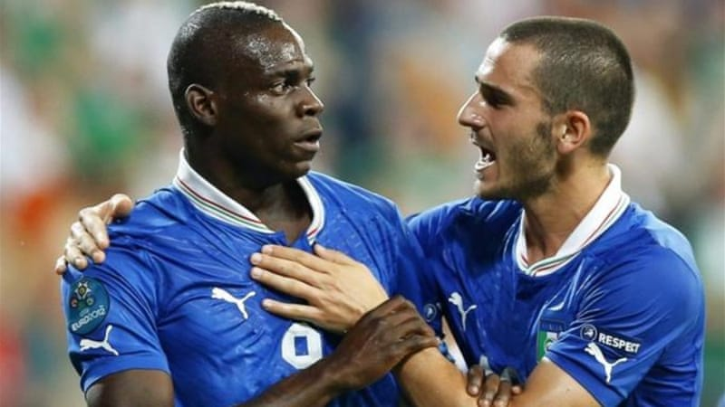 Italy's Mario Balotelli, left, celebrates with his teammate Leonardo Bonucci after scoring the 2-0 lead [EPA]