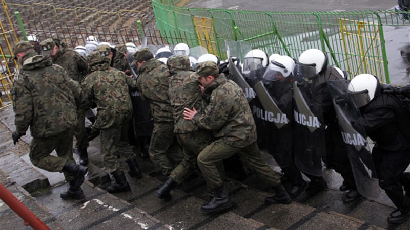 Polish security forces have simulated exercises of crowd riots as part of their preparations for the tournament [EPA]