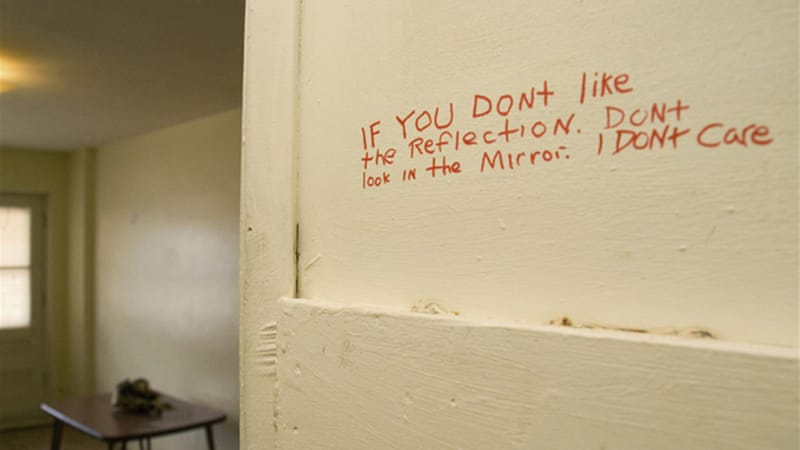 Writing on the wall of a closet in the apartment where Luka Rocco Magnotta lived in Montreal [Reuters]