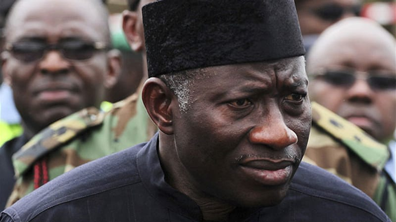 The defections are a blow to President Goodluck Jonathan's 2015 re-election bid [Reuters]