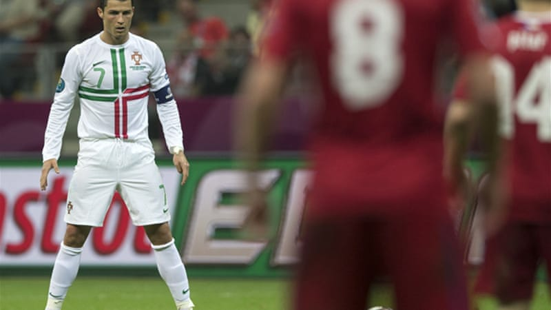 Man of the moment: Ronaldo's goals have won consecutive matches at Euro 2012, sending Portugal into Wednesday's semi-finals [EPA]