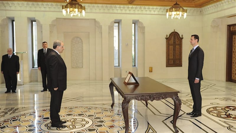 Assad swore in members of a new cabinet on Tuesday, part of the latest government shake-up in Damascus [Reuters]