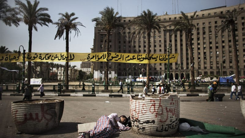 Hundreds of demonstrators are occupying Tahrir Square after a court sentenced Mubarak to life in prison [AFP]