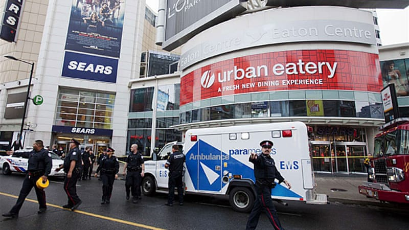 A gunman is still at large after opening fire in one of Toronto's top tourist destinations, Eaton Centre [Reuters]