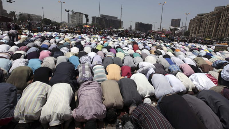 Several groups of protesters began marching to the square after Friday prayers in mosques around Cairo [Reuters]