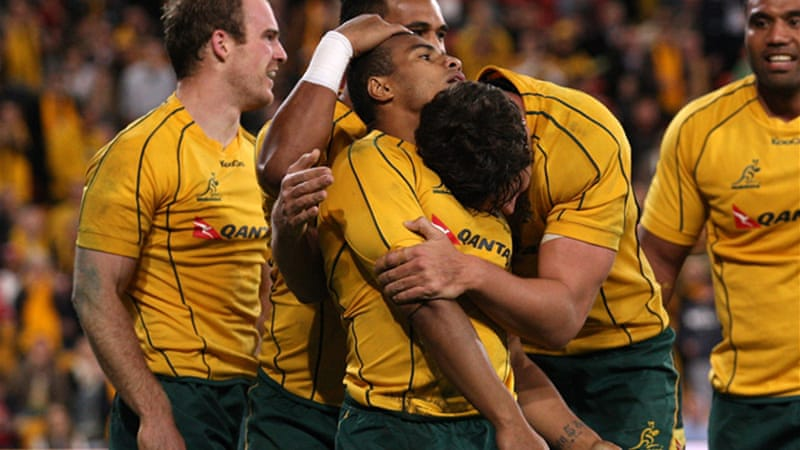Will Genia (C) scored a try and created another as Wallabies defeated Six Nations champions Wales [GETTY]