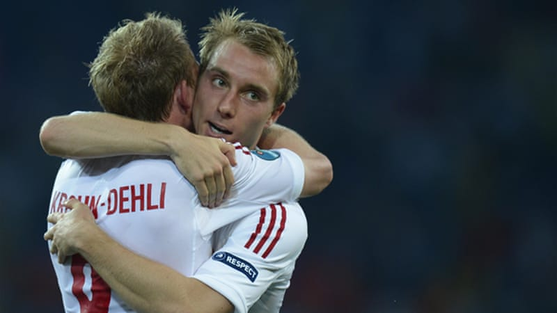 Danish midfielder Michael Krohn-Dehli (L) and forward Tobias Mikkelsen celebrate after unlikely win [AFP]