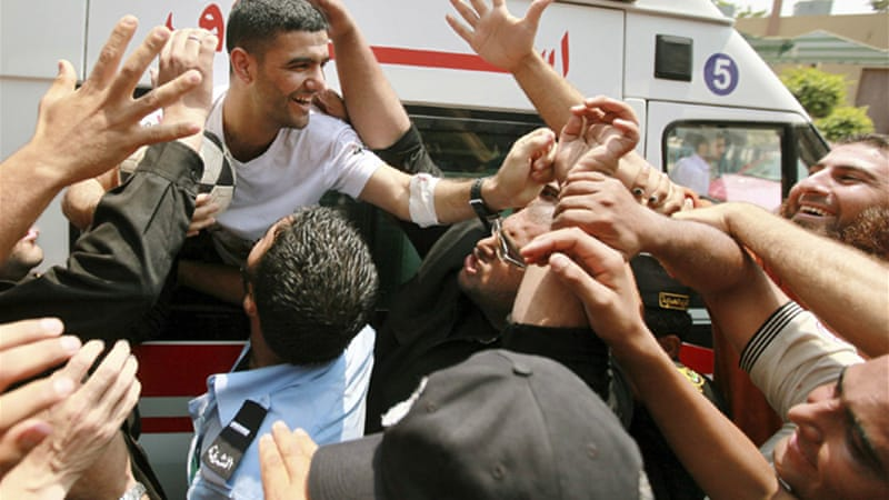 Mahmoud Sarsak was greeted upon his arrival in Gaza after he spent three years behind bars without trial [Reuters]