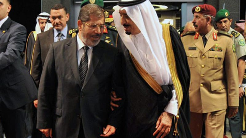While the Saudi Crown Prince greeted Mohammed Morsi upon his arrival in Jeddah, he left the country alone [AFP]