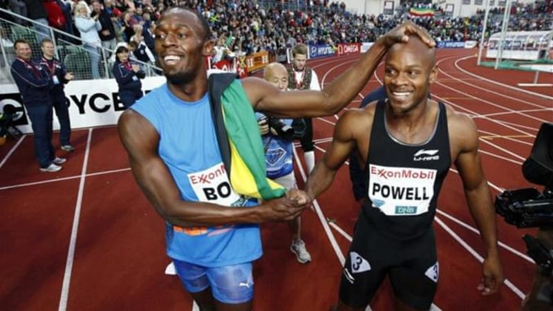 Asafa Powell (R) will hope to take on compatriot Usain Bolt (L) at the upcoming Olympics [Reuters]