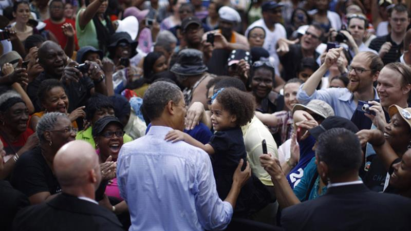 Obama kept up his attack on Romney as he rallied supporters in Virginia state on Saturday [Reuters]