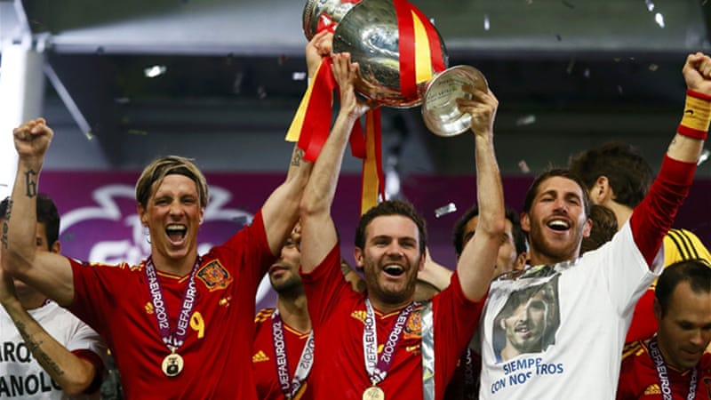 Awards all round: Spain secured a third-straight major title on Sunday night as Iniesta collected the man-of-the-match award and Fernando Torres, left, collected the Golden Boot [EPA]