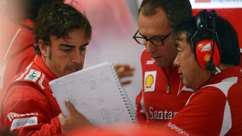 Despite the win Domenicali, pictured centre with Alonso, said he thought Red Bull and McLaren were still quicker and that Ferrari would need to push hard at the Hungary GP next week [EPA]