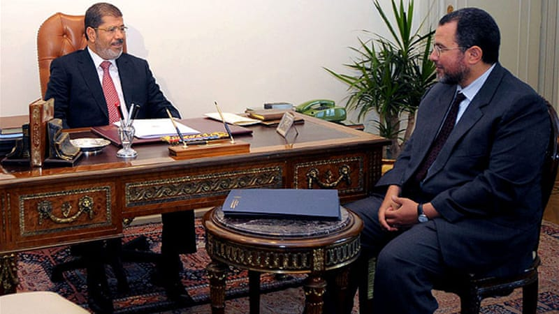 Egyptian President Mohamed Morsi, left, has tasked Hesham Mohammed Qandil with forming a new cabinet [EPA]