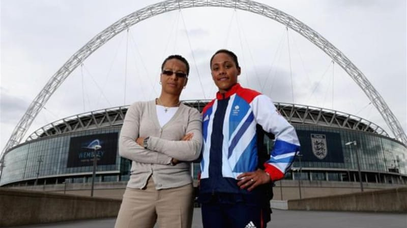 Team GB coach Hope Powell and Alex Scott in front of Wembley Stadium - where the games begin [GETTY]