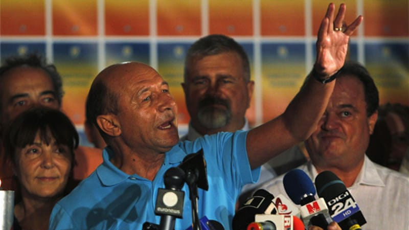 Suspended President Traian Basescu celebrates after the first results of the referendum were announced [Reuters]