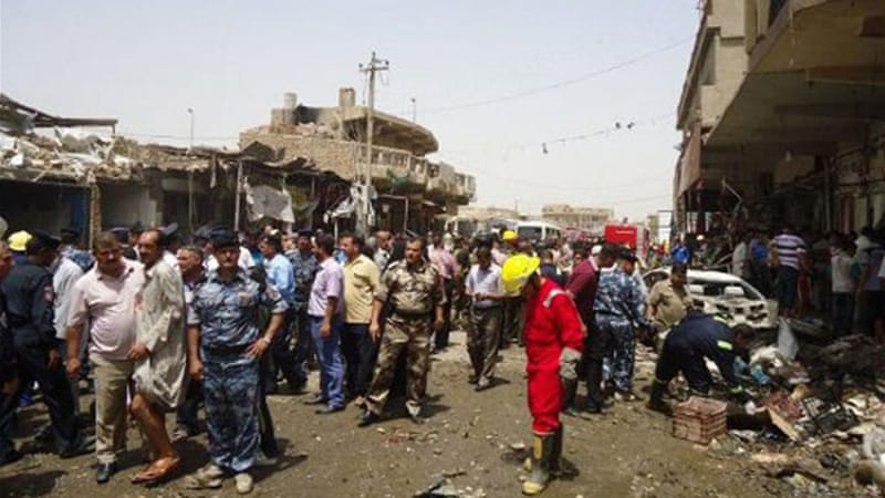About 25 people were killed after a truck bomb exploded in a busy market in the city of Diwaniya on Tuesday [AFP]