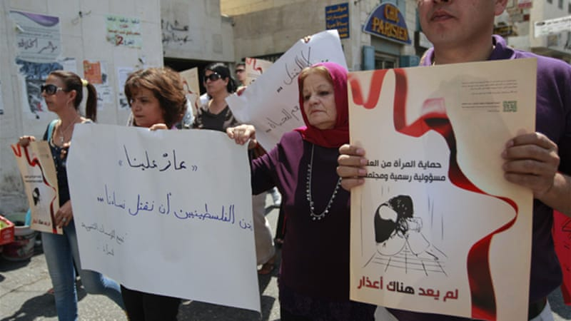 A protest was held in the spot where Nancy Zaboun had her throat slit earlier this week after filing for divorce [AP]